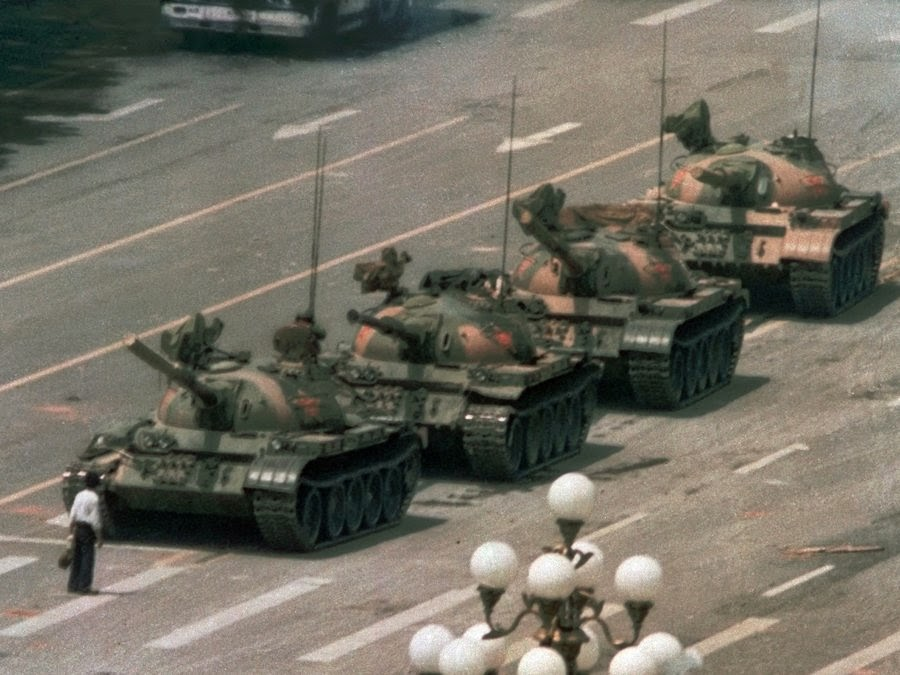 Iconic photo of a lone man facing down four tanks in Tiananmen Square