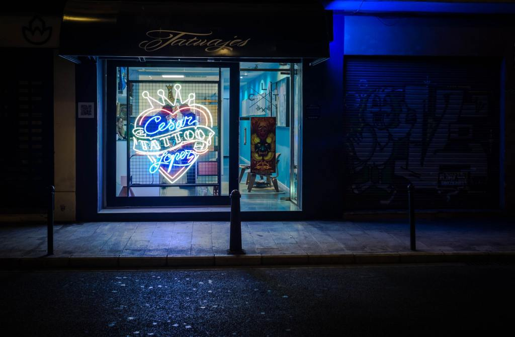 Photo of neon tattoo sign during nighttime