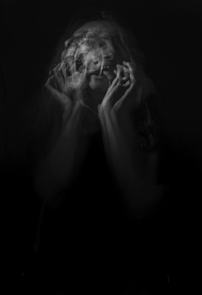 Multiple exposures of a woman screaming and crying