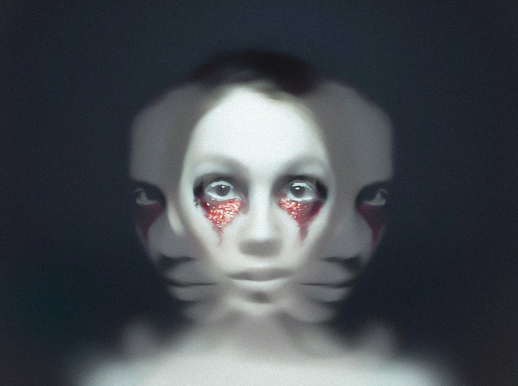Triple exposure of a face with triangle makeup under the eyes